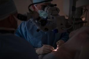 Asheville Eye Associates doctor checks patient's perscription